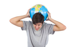 Man suffering because of a globe Stock Image