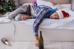 The man suffering hangover after christmas party. Man suffering hangover after christmas party Royalty Free Stock Image