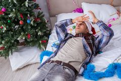 The man suffering hangover after christmas party. Man suffering hangover after christmas party Royalty Free Stock Photos
