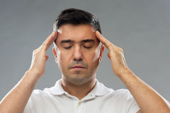 Man suffering from head ache or thinking Royalty Free Stock Image