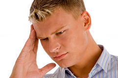 Man suffering from head pain. Against white background Royalty Free Stock Photography