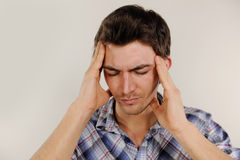 Man suffering from headache. Mid adult man suffering from headache Royalty Free Stock Photos