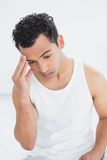 Man suffering from headache in bed Royalty Free Stock Photo