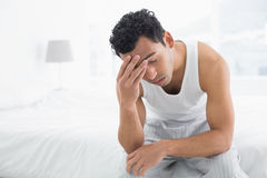 Man suffering from headache in bed Royalty Free Stock Images