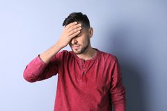 Man suffering from headache. On color background Royalty Free Stock Photo