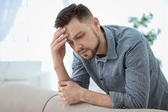 Man suffering from headache. At home Royalty Free Stock Photography