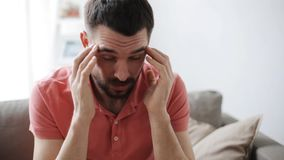 Man suffering from headache at home. Health care, pain, stress, age and people concept - man suffering from headache at home stock video footage