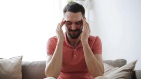 Man suffering from headache at home stock video footage