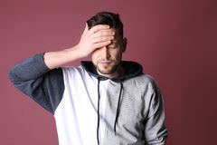 Man suffering from headache. On color background Stock Image