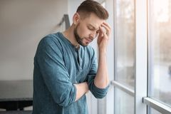 Man suffering from headache. At home Royalty Free Stock Image