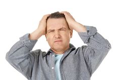 Man suffering from headache. On white background Royalty Free Stock Photos