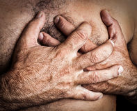 Man suffering a heart attack. Grunge image of a topless man suffering a heart attack Royalty Free Stock Photo