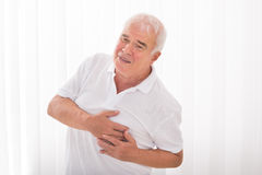 Man Suffering From Heart Attack Stock Photo