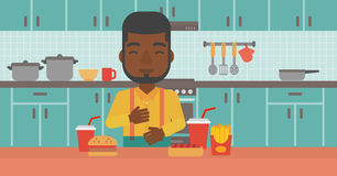 Man suffering from heartburn. An african-american man standing in the kitchen in front of table full of junk food and suffering from heartburn vector flat Royalty Free Stock Photo