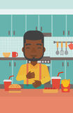 Man suffering from heartburn. An african-american man standing in the kitchen in front of table full of junk food and suffering from heartburn vector flat Stock Images