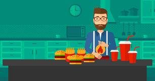 Man suffering from heartburn. A hipster man with the beard standing in the kitchen in front of table full of junk food and suffering from heartburn vector flat Stock Photo