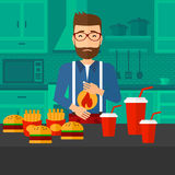 Man suffering from heartburn. A hipster man with the beard standing in the kitchen in front of table full of junk food and suffering from heartburn vector flat Royalty Free Stock Photos
