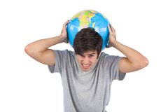 Man suffering while holding a globe Royalty Free Stock Photos
