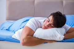 The man suffering from insomnia lying in bed Stock Images