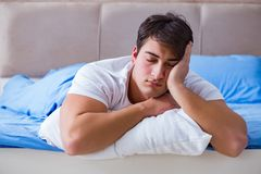 The man suffering from insomnia lying in bed Royalty Free Stock Images