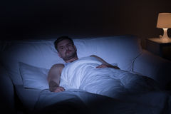 Man suffering from insomnia. View of man at night suffering from insomnia Stock Images