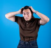 Man suffering from itchy scalp. Young man suffering from itchy scalp royalty free stock image