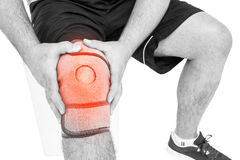 Man suffering with knee cramp against white background Stock Image