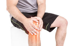 Man suffering with knee inflammation against white background Stock Photography