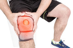 Man suffering with knee inflammation. Digitally composite image of man suffering with knee inflammation Stock Photography