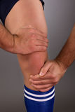 Man suffering from knee pain Royalty Free Stock Photography