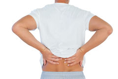 Man suffering from lower back pain. On white background Royalty Free Stock Images