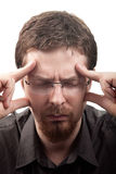 Man suffering from migraine or headache. Over white stock image