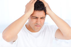 Man suffering from a migraine on waking Stock Photography