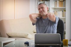Man suffering from neck pain Royalty Free Stock Images