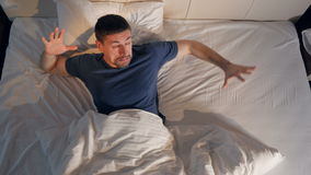Man suffering from the nightmare. 4K. The close-up of the man suffering from the nightmare stock footage