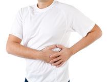 Man suffering from pain in the left side. On a white Stock Image