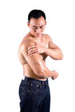 Man suffering pain on shoulder. Muscular man suffering from discomfort and pain on shoulder royalty free stock photos