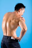 Man suffering from pain on shoulder stock photo
