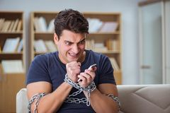 The man suffering from phone dependence addiction. Man suffering from phone dependence addiction Stock Images