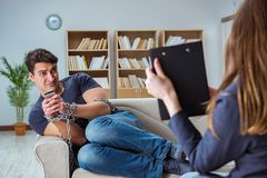 The man suffering from phone dependence visiting doctor Stock Photos