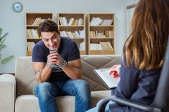 The man suffering from phone dependence visiting doctor Royalty Free Stock Photos
