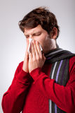 Man suffering from running nose Royalty Free Stock Image