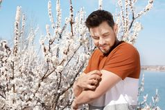Man suffering from seasonal allergy outdoors royalty free stock images