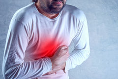 Man suffering from severe abdominal pain, hands on stomach Royalty Free Stock Image