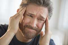 Man Suffering From Severe Headache Stock Photography