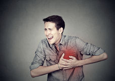 Man suffering from severe sharp heartache, chest pain. Adult man suffering from severe sharp heartache, chest pain. Heart disease concept Royalty Free Stock Photos