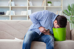 The man suffering from sick stomach and vomiting Stock Photography