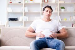 The man suffering from sick stomach and vomiting. Man suffering from sick stomach and vomiting Stock Images