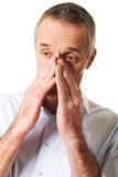 Man suffering from sinus pressure pain Stock Images
