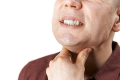 Close Up Of Man Suffering With Sore Throat. Man Suffering With Sore Throat Stock Photo